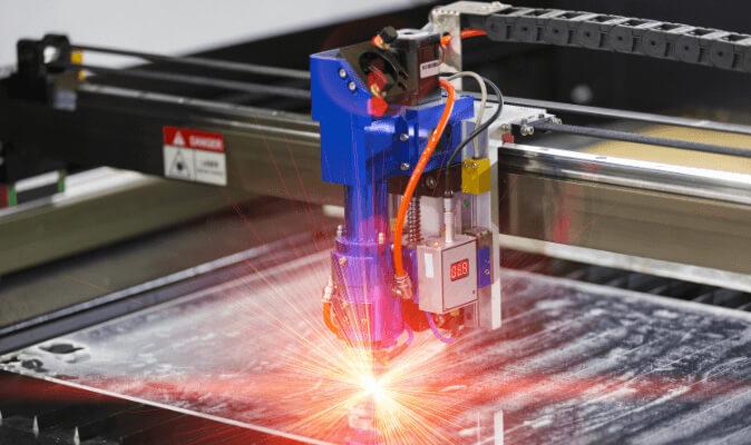 Custom Technologies laser cutter sparks